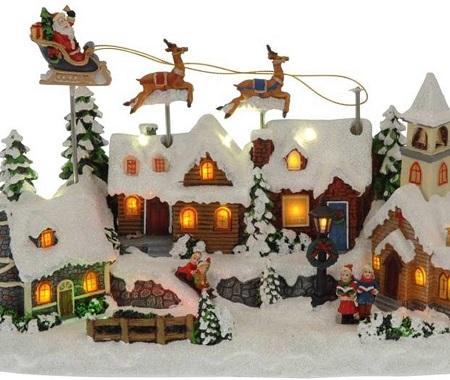 Kerstdorp met bewegende arreslee en led verlichting.