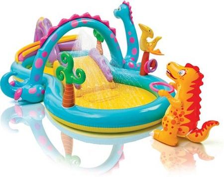 Opblaasbaar speelzwembad Dinoland Play Centre met glijbaan en waterval.
